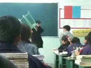 谁知道中学老师拿凳子打学生的具体情况?